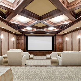 Inspiration for a large traditional enclosed home cinema in Atlanta with beige walls, carpet and a projector screen.