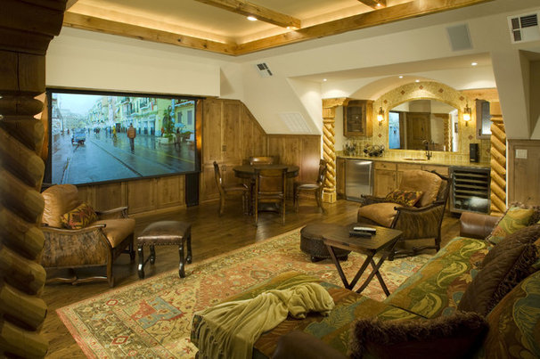 Rustic Home Theater by CB Construction Company
