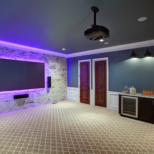 Example of a large transitional enclosed carpeted home theater design in Oklahoma City with blue walls and a wall-mounted tv