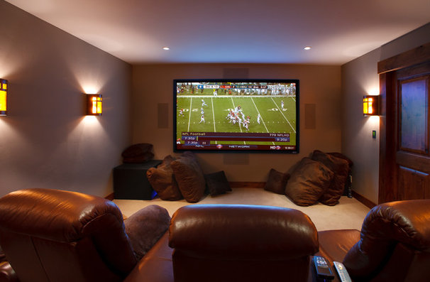 Rustic Home Theater by Teton Heritage Builders
