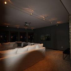 Contemporary Home Theater by Jerry Bussanmas