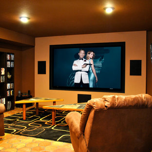 Inspiration for a large country enclosed home theatre in Phoenix with orange walls, terra-cotta floors, a projector screen and orange floor.