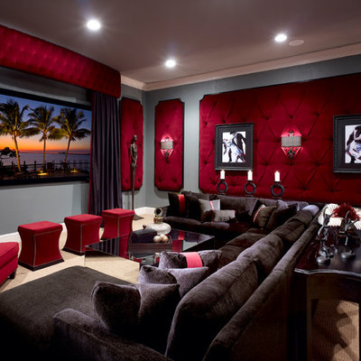 Example of a large classic enclosed carpeted home theater design in Orlando with gray walls and a wall-mounted tv