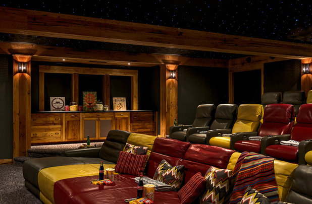 Rustic Home Theater by TMS Architects