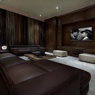 オーランドのトランジショナルスタイルのおしゃれなシアタールーム (カーペット敷き、グレーの床) の写真