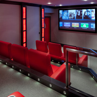 Home theater - contemporary enclosed home theater idea in Boston with a wall-mounted tv