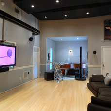 Eclectic Home Theater by RD Architecture, LLC