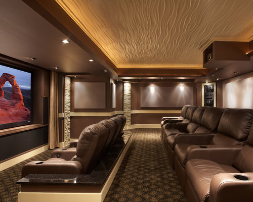 best home theater design. Trendy home theater photo in DC Metro with brown walls and a projector  screen Best Home Theater Houzz