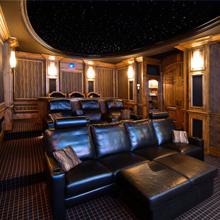 Inspiration for a timeless enclosed carpeted and multicolored floor home theater remodel in Sacramento with a projector screen