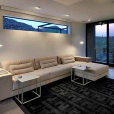 Contemporary Home Theater by Process Design Build, L.L.C.