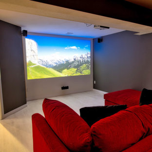 Home theater - contemporary vinyl floor and white floor home theater idea in San Diego with gray walls