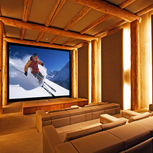 Home Theater   Rustic Enclosed Carpeted And Beige Floor Home Theater Idea  In Denver With Brown