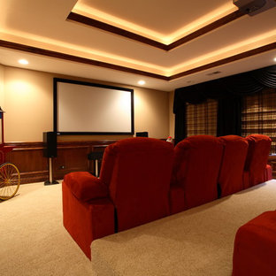 Elegant enclosed home theater photo in Tampa with a wall-mounted tv