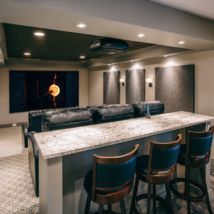 Inspiration for a mid-sized modern enclosed carpeted and gray floor home theater remodel in DC Metro with gray walls and a projector screen