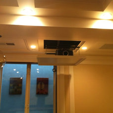 Transitional Home Theater by Allwood Construction Inc