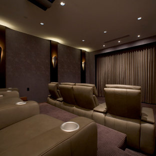 Design ideas for a large contemporary enclosed home theatre in Los Angeles with pink walls, carpet and a projector screen.