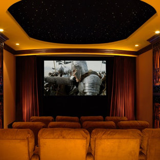 Home theater - traditional home theater idea in Los Angeles with a projector screen
