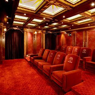 Elegant red floor home theater photo in Austin