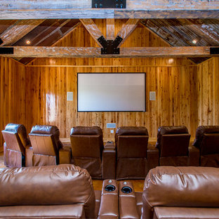 Home theater - huge rustic home theater idea in New Orleans