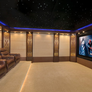 Home theater - mid-sized contemporary enclosed carpeted and beige floor home theater idea in Houston with beige walls and a projector screen