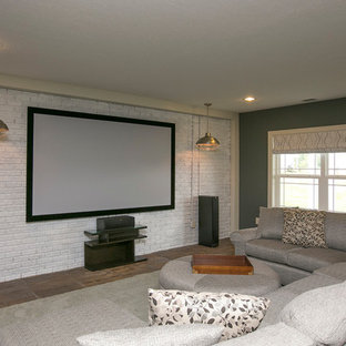 Design ideas for a traditional home cinema in Columbus with green walls and dark hardwood flooring.