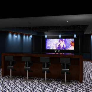 Home theater - large modern enclosed carpeted and multicolored floor home theater idea in New York with blue walls and a projector screen