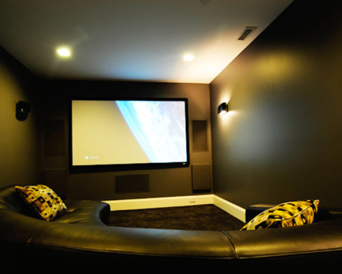 enclosed home theater idea in vancouver with a wall mounted tv