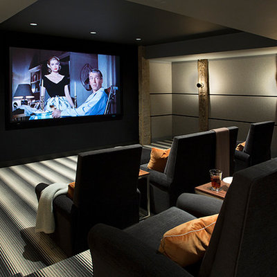 Home theater - mid-sized cottage enclosed carpeted and gray floor home theater idea in Boston with gray walls and a projector screen