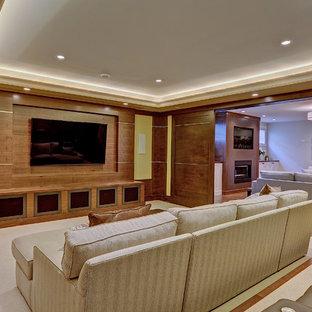 Mittelgroßes Klassisches Heimkino mit Teppichboden, Wand-TV, beigem Boden und gelber Wandfarbe in Calgary