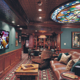 Example of a large classic open concept carpeted and multicolored floor home theater design in Other with green walls and a wall-mounted tv