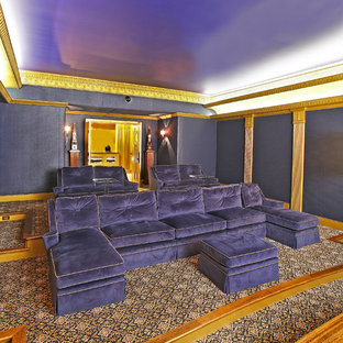 Home theater - eclectic enclosed carpeted and multicolored floor home theater idea in Dallas with blue walls