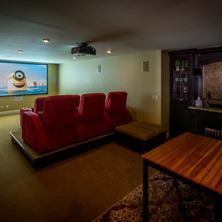 Mid-sized modern open concept home theatre in Calgary with brown walls, carpet and a projector screen.