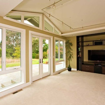 media room with vaulted ceiling and french doors