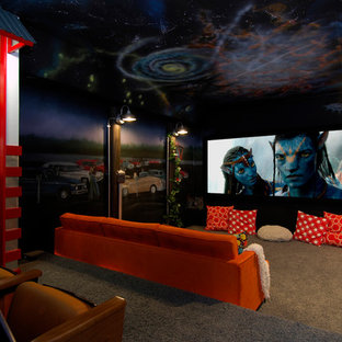 Home theater - eclectic gray floor home theater idea in Denver