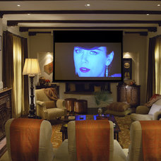 Mediterranean Home Theater by Tommy Chambers Interiors, Inc.