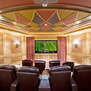 Inspiration for a mediterranean home theatre in Other with pink walls.