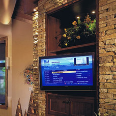 Traditional Home Theater by Current Concepts Home Automation
