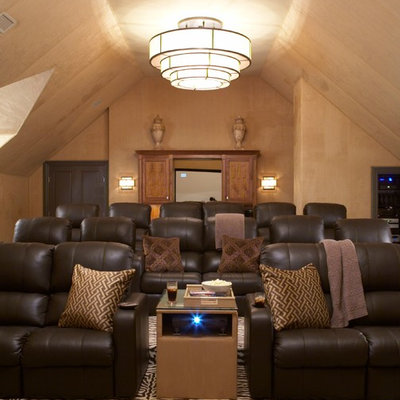 Example of a large classic enclosed carpeted and multicolored floor home theater design in New York with beige walls and a projector screen