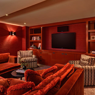 Example of a 1950s home theater design in Portland with red walls and a wall-mounted tv