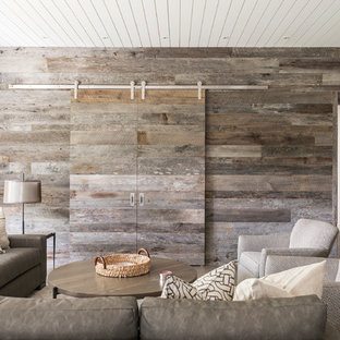 Design ideas for a large country open concept home theatre in Other with white walls, concrete floors, a built-in media wall and grey floor.