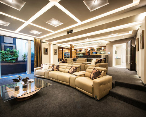 This Is An Example Of A Transitional Enclosed Home Theatre In Perth With  Beige Walls,