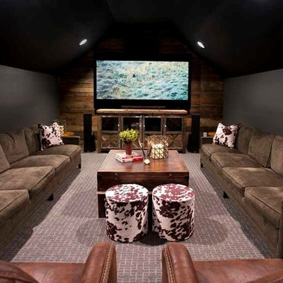 Home theater - mid-sized cottage enclosed carpeted home theater idea in Nashville with a media wall