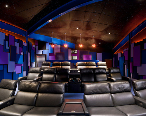 Merveilleux Example Of A Large Trendy Enclosed Carpeted And Blue Floor Home Theater  Design In Cleveland With
