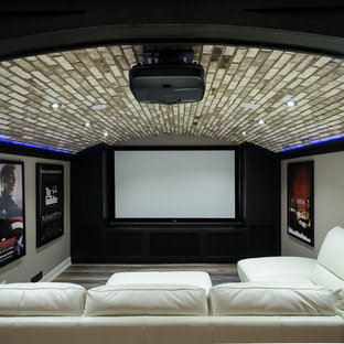 Design ideas for a mid-sized contemporary open concept home theatre in Calgary with grey walls, vinyl floors and a projector screen.