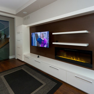This is an example of a mid-sized modern open concept home theatre in Toronto with grey walls, light hardwood floors and a wall-mounted tv.