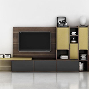 Trendy home theater photo in New York with a media wall