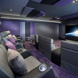 This is an example of a contemporary enclosed home cinema in Los Angeles with purple walls, carpet, a projector screen and purple floors.