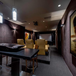 Design ideas for a small modern enclosed home cinema in Calgary with purple walls, carpet and a projector screen.
