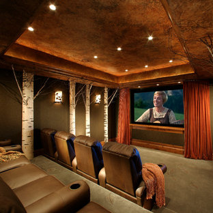Large traditional enclosed home cinema in Phoenix with a projector screen, green walls, carpet and green floors.