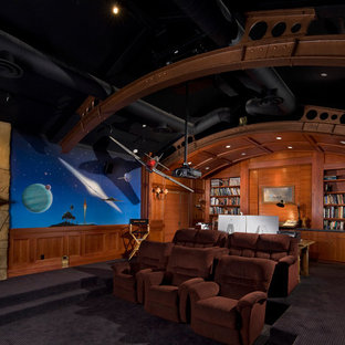 Southwest enclosed carpeted and black floor home theater photo in Santa Barbara with multicolored walls and a projector screen